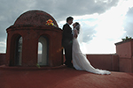 San Miguel rooftop wedding embrace