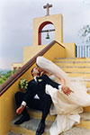a wedding kiss on the steps